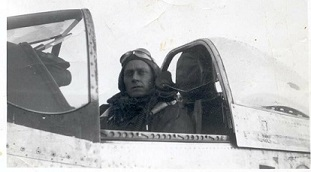 Ralph in the cockpit of his P-51 Mustang 'Debra Dell'--Duxford, England, 1944.