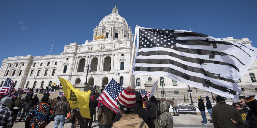 t's a grand old flag: Opponents of gun control, rallying at the Minnesota Capitol in St. Paul in 2018, fly their own version of the U.S. flag., From InText