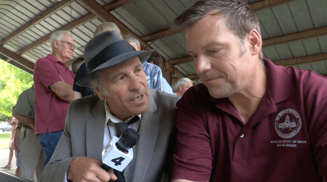 Greg Palast  and Kris Kobach
