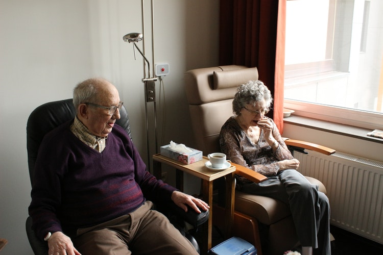 Elderly man and woman sitting