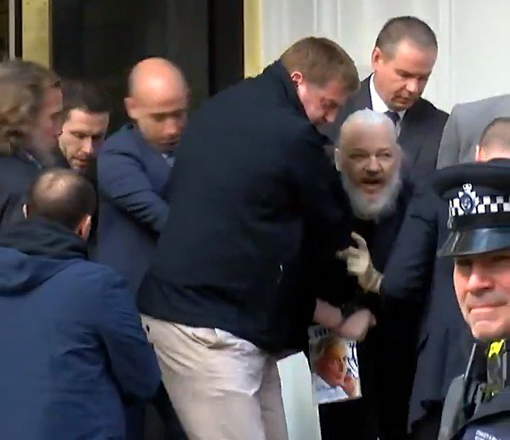 Assange getting dragged out of embassy, April 11, 2019., From InText