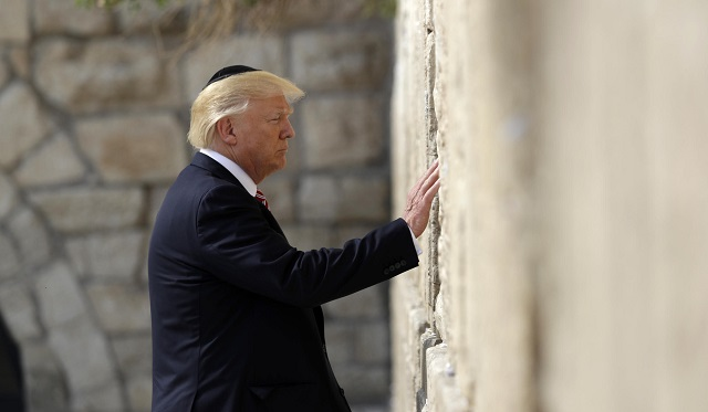US President Donald Trump's decision to move the American embassy in Israel to Jerusalem in May 2018 appeared to pre-empt negotiations determining Jerusalem's status by implying US recognition of exclusive Israeli sovereignty over the city, From InText