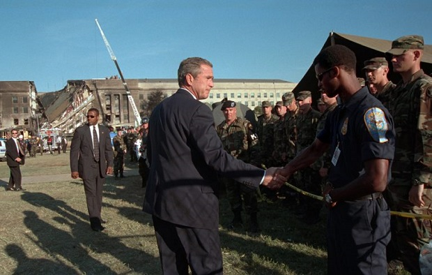 President George W Bush greets rescue workers firefighters and military personnel Sept 12 2001 while surveying damage