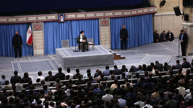 Ayatollah Khamenei addressing a group of young students.