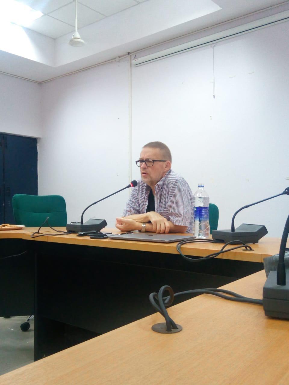 author speaking at JNU