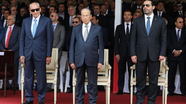Lebanese President Michel Aoun (C), Speaker of the Parliament Nabih Berri (L) and Prime Minister Saad Hariri attend a ceremony marking the 74th anniversary of the founding of Lebanese Armed Forces at the military academy in Beirut, Lebanon, on 1 August 20