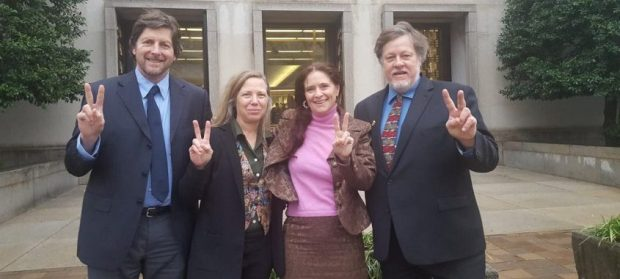 Embassy protectors [left to right: David Paul, Margaret Flowers, Adrienne Pine, Kevin Zeese] outside of court on February 13, 2020.