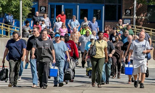 Autoworkers getting off a shift at the Fiat Chrysler stamping plant in Warren, Michigan