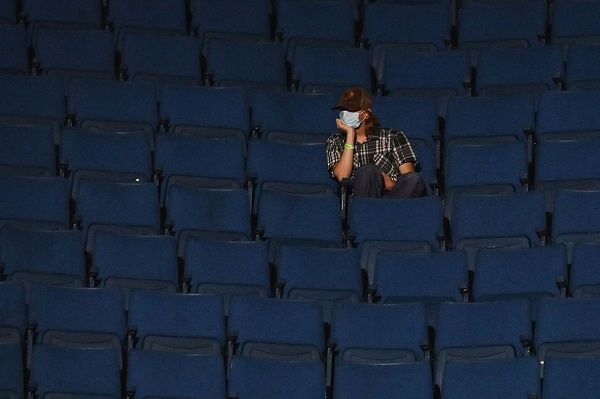 A lone attendee at the BOK Center in Tulsa Okla. waits for President Donald Trump to take the stage on Saturday, From InText