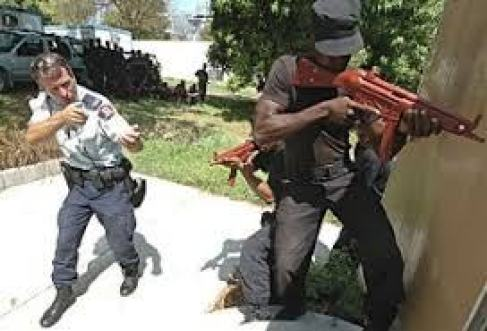 An RCMP officer training Haitian National Police recruits