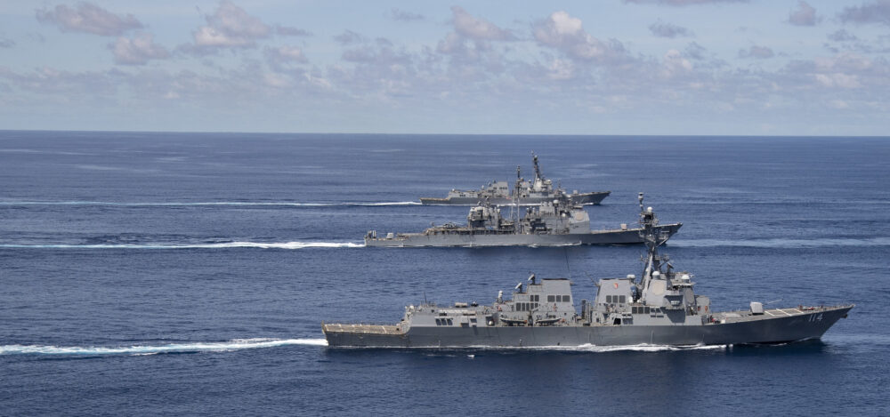 The Nimitz Carrier Strike Group steams in formation during a cooperative deployment in the Indian Ocean on July 20, 2020, From InText