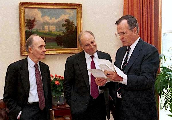 President George H. W. Bush examines papers with Sec. Dick Cheney and Gen. Brent Scowcroft in the Oval Office, April 19, 1989., From InText