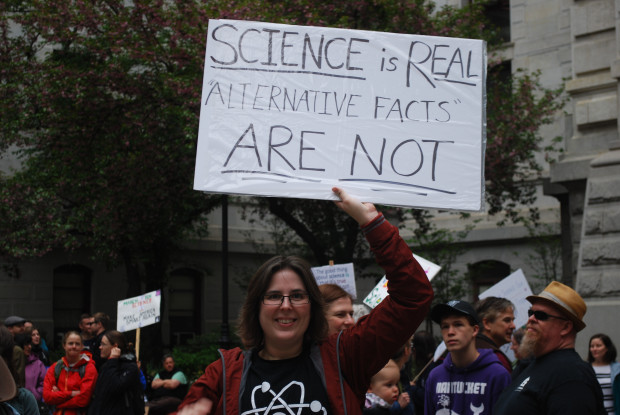 Woman holds a sign at the March for Science in Center City Philadelphia, April 22, 2017.
