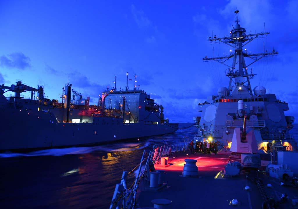 U.S. guided-missile destroyer, right, receiving fuel during an underway replenishment while patrolling Indo-Asia-Pacific region, 2015.