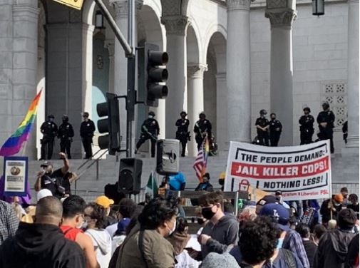 Riot police stand guard over peaceful celebration in Los Angeles