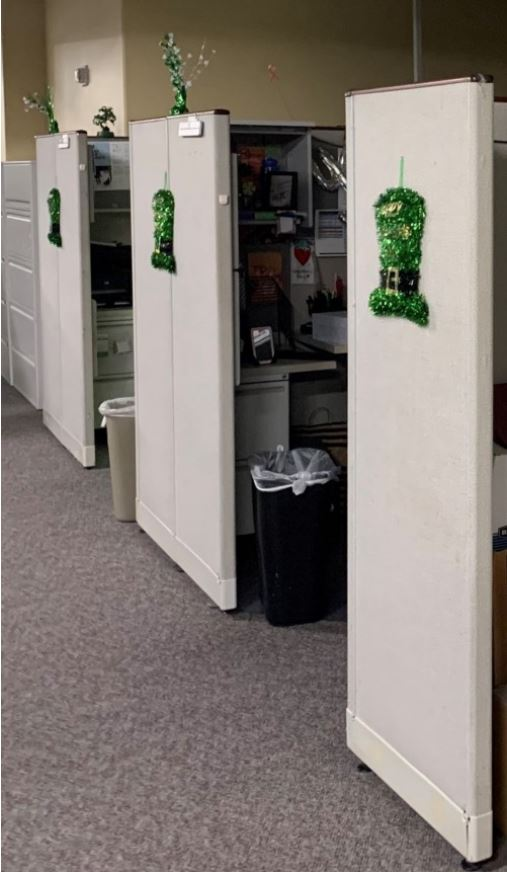 Abandoned cubicles decorated for St. Patrick's Day in July